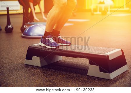 Close-up man Step for exercises in the gym with an athlete's foot.high contrast and monochrome color tone. Consept Weight Loss.