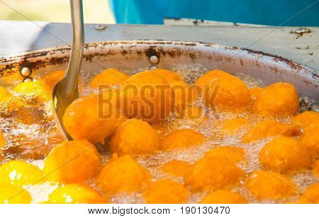 Homemade fritters with sugar and its ingredients latin food, called huevos chilenos.