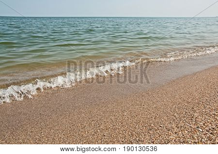 Beautiful seascape. Shells beach and clear blue water