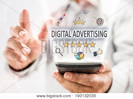 Digital Advertising Concept With Smart Phone On Businessman's Hand