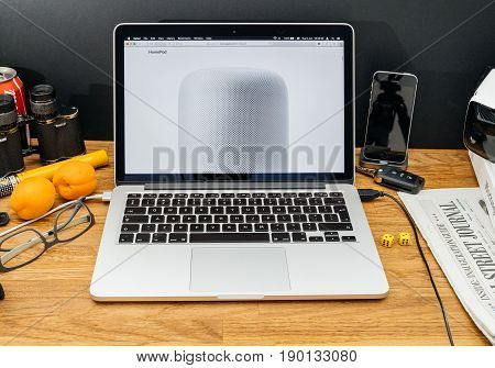 PARIS FRANCE - JUNE 6 2017: Apple Computers website on MacBook Retina in creative environment showcasing latest news from Apple at WWDC 2017 - introducing the HomePod a high-fidelity virtual surround sound speaker with Siri support.