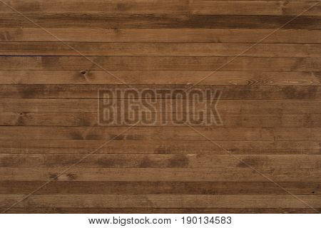 Large dinner empty wood table top. Wood table texture background. Plank board of wood table. Wood table worktop. Empty wood table for product placement or montage. Wood table top view. Wood table surface. Rustic wood table background.