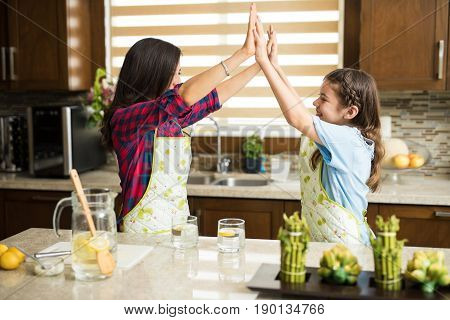 Mom And Daughter Working Together In The Kitchen