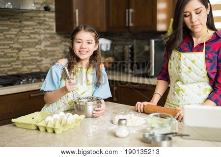 Cute Girl Cooking With Her Mom