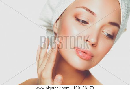 Portrait of beautiful girl touching face with a towel on her head