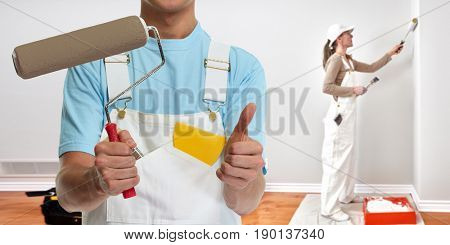 Painter hand with painting roller