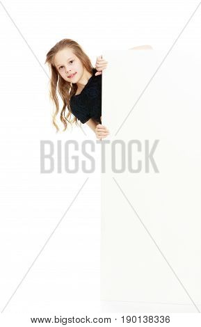 Beautiful little girl with her long hair peeks out from behind the banner.Isolated on white background.