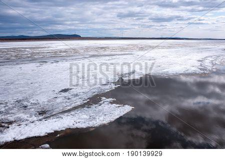 Amur River under the ice embankment of Komsomolsk-on-Amur