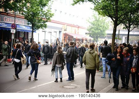 MAINZ, GERMANY - MAY 27: Pedestrians demonstrators and onlookers walking along a street in Kreuzberg at the annual 1st May demonstration on May 01 2017 in Berlin.
