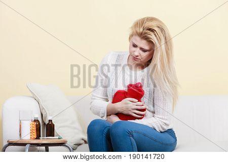 Woman Feeling Stomach Cramps Sitting On Cofa