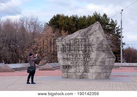 Russia, Komsomolsk-on-Amur, April 21: The tourist photographs city historical places