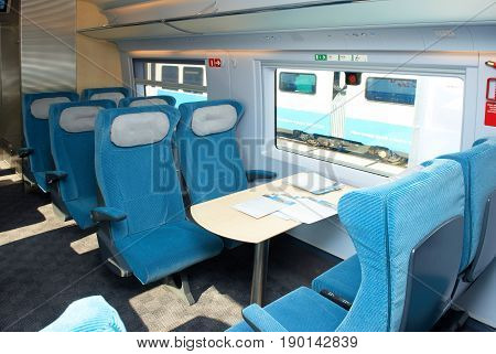 MOSCOW, SEP,18, 2011, Exhibition EXPO1520: Modern new generation high speed passenger train saloon interior chairs seats tables. High speed train Sapsan Siemens. Event organizer Business Dialogue