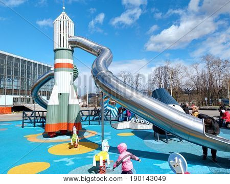 VDNKH, MOSCOW, APR,23, 2017: Incredible unusual fantastic colorful space aerospace childred playground entertainment joy with USSR famous rockets VOSTOK, SOUZ with metal slides, lunar rover Lunokhod