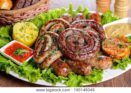 Assorted Bavarian sausages garnished with greens and sauces