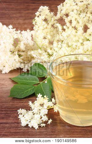 Fresh Healthy Juice And Elderberry Flowers On Board