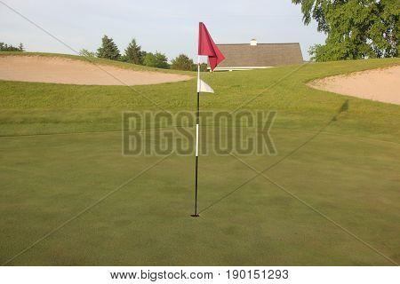 A golf course flagstick (