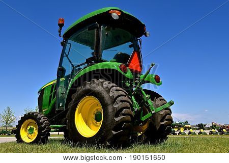 MOORHEAD, MINNESOTA, May 31, 2015: The new John Deere 3046R tractor is a product of the John Deere Co, an American corporation that manufactures agricultural, construction, forestry machinery, diesel engines, and drivetrains.