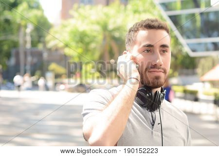 Latin Man Talking On The Phone.