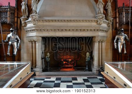 Suits of armor standing guard beside big fireplace