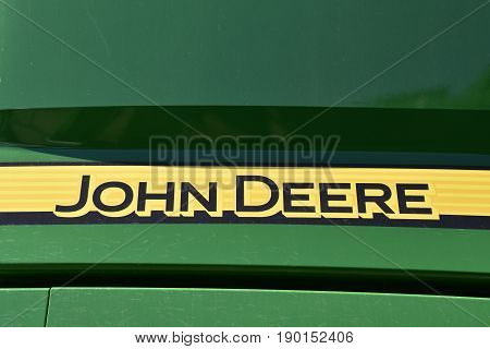 MOORHEAD, MINNESOTA, May 31, 2015: The new JOHN DEERE words identify machinery for the John Deere Co, an American corporation that manufactures agricultural, construction, forestry machinery, diesel engines, and drivetrains.