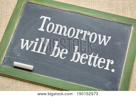 Tomorrow will be better  - positive text  vintage slate blackboard with a white chalk against burlap canvas