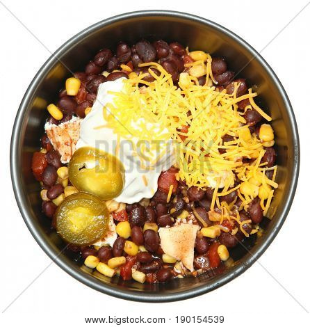 Black Bean and Corn with Grilled Chicken in bowl isolated over white.