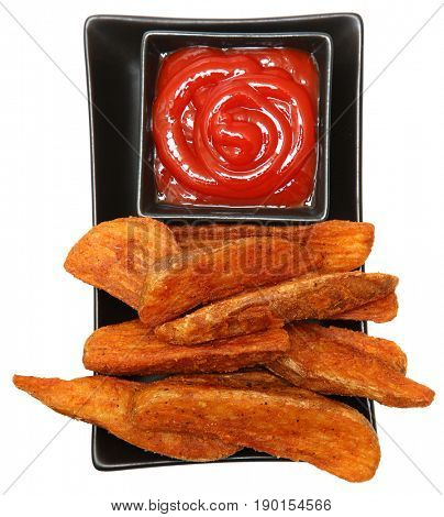 Fried Potato Wedges and Ketchup over white.