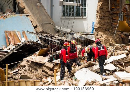 Quito, Ecuador - December 09, 2016: An unidentified group of firemans, Damage and destruction in building After Fire Inferno.