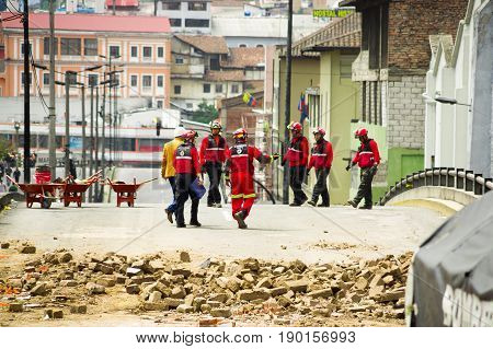 Quito, Ecuador - December 09, 2016: An unidentified group of firemans walking around and cheking the damage and destruction in buildings after Fire Inferno.