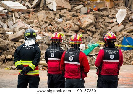 Quito, Ecuador - December 09, 2016: An unidentified group of firemans watching the damage and destruction in building After Fire Inferno.