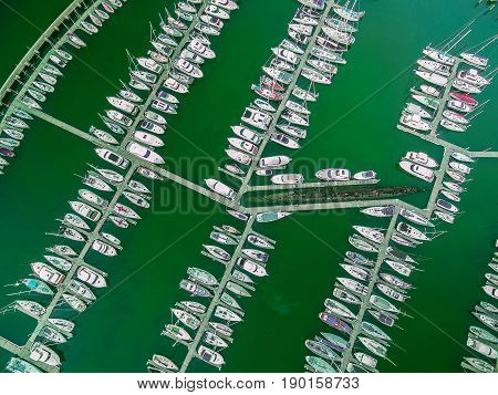 Looking Straight Down At Moored Sailboats And Old Decommissioned Submarine. Aerial View