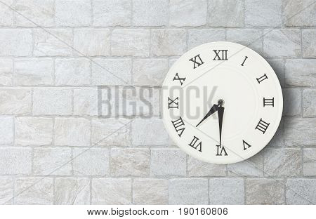 Closeup white clock for decorate show half past seven o'clock or 7:30 a.m. on old brick wall textured background with copy space in interior concept