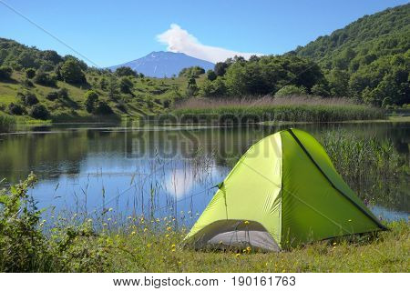 wild camp on Biviere Lake in Nebrodi Park, on background Etna Mount, Sicily