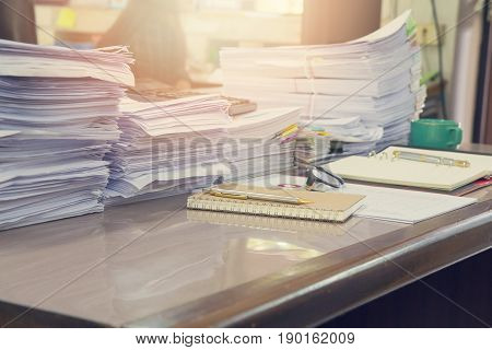 Pile Of Unfinished Documents On Office Desk, Stack Of Business Paper, Vintage Effect