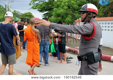 Ratchaburi Thailand - October 18 2016:Thai police support people and Buddhist monks in the end of Buddhist Lent Day.