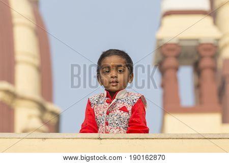 NEW DELHI INDIA - JANUARY 24 2017 : Indian child in Shri Lakshmi Narain Temple . New Delhi India