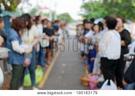Abstract blurred of people line up at temple in the end of Buddhist Lent Day.