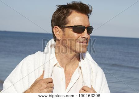 Caucasian man walking on beach