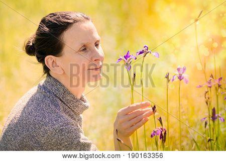 Woman Looking A Wild Iris Sibirica Flower