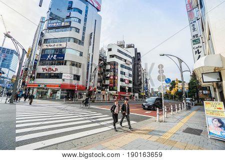 people cross zebra-crossing in the morning taken in Tokyo Japan on 8 December 2016