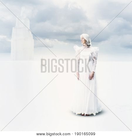 Caucasian woman wearing wedding gown in clouds
