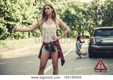 Girls Having Problem With Car