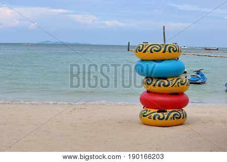 Stack of colorful floating rings on the beachswim ring rubber ring swimming tubes