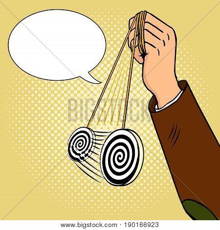 Hand of hypnotist with pendulum pop art style vector illustration. Comic book style imitation.