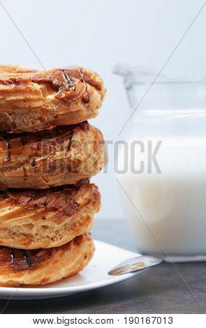 Glazed Doughnuts on a dessert plate. Vertical photo