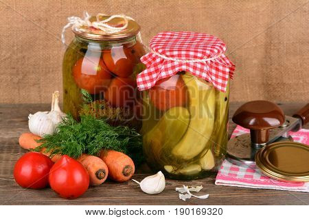 Home canning, canned vegetables on wooden table