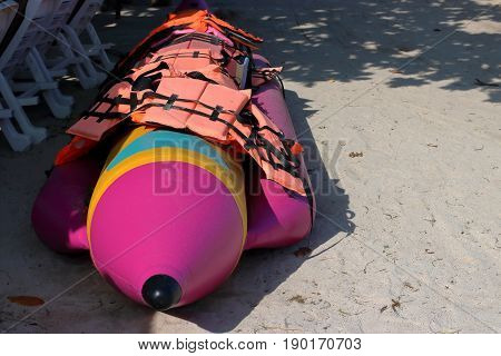 Banana boat and safety life jacket on the beach