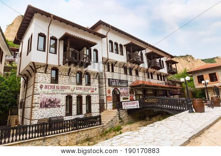 Melnik, Bulgaria - May 11, 2017: Street view with traditional bulgarian houses and wine museum in Melnik town, Bulgaria