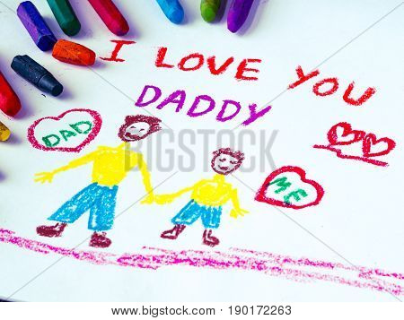 Kid drawing of father holding his child for happy father's day theme with I LOVE YOU DADDY message.