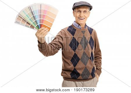Elderly man holding a color swatch and looking at the camera isolated on white background